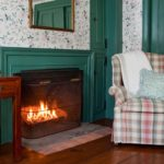 The fireplace in the Orchard Room at Stonecroft Country Inn in Mystic Country, CT