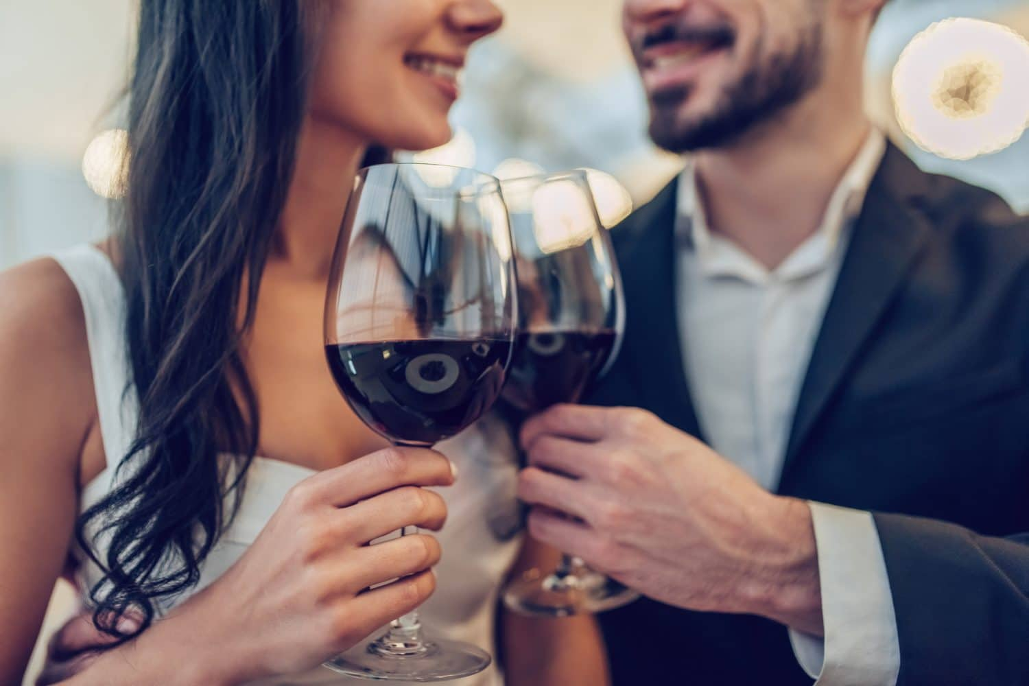 Romantic couple enjoying a glass of wine and all the things to do in Niantic, CT