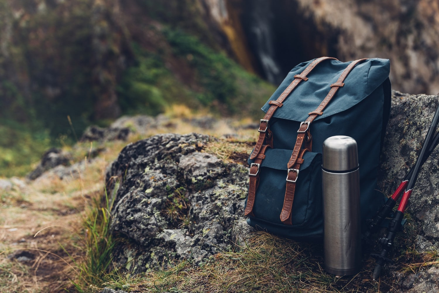 Hipster Blue Backpack, Thermos And Trekking Poles Closeup, Front View | Lantern Hill in Ledyard, CT
